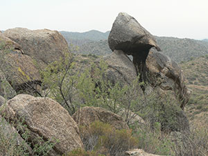Rock formations amid shrubby vegetation