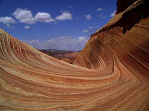 The Wave - a unique rock formation of gruesomely-twisted, orange, red and white sandstone ending in delicate fluted edges.