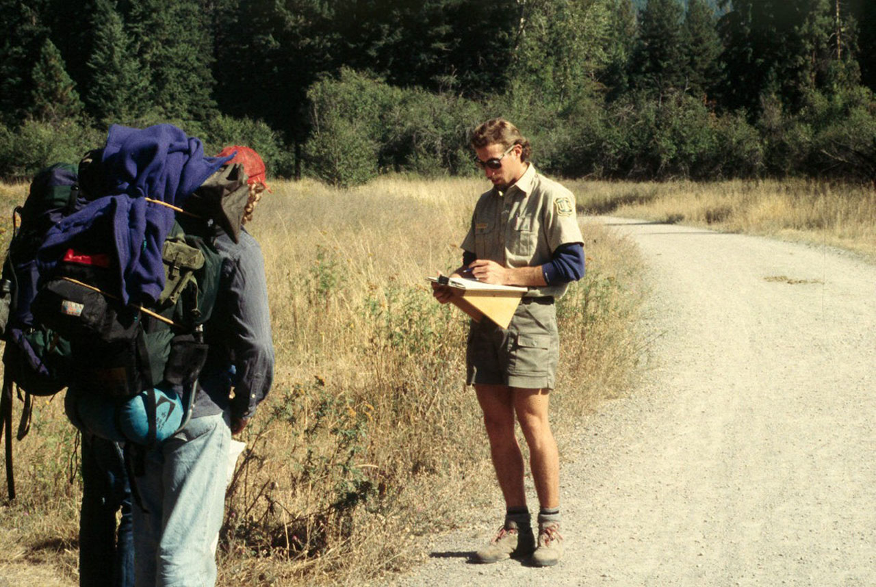 Ranger conducting an interview in the field