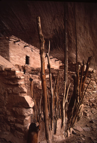 A pueblo house in Keet Seel, Navajo National Monument. A mud brick wall and stick mud fence surround the house.