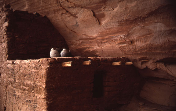 Two pots sit on a wall at Keet Seel, a large ancestral Puebloan cliff dwelling.