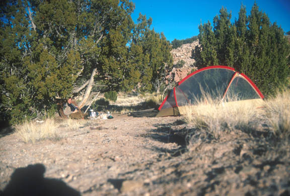 Campsite and a camper in the Bandelier Wilderness. An example of at-large camping.