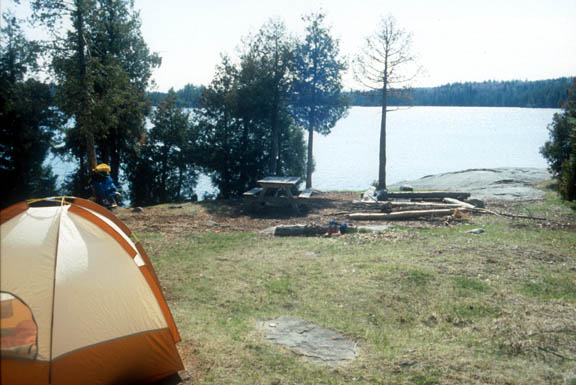 Cherokee Lake Island campsite. The sun illuminates the lake.