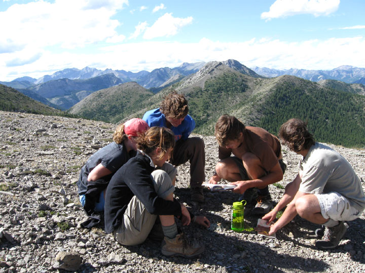 Students huddle together, collecting data during the University of Montana's Wilderness and Civilization Field Studies Fall 2008 Trek somewhere atop a mountain in the Bob Marshall Wilderness.