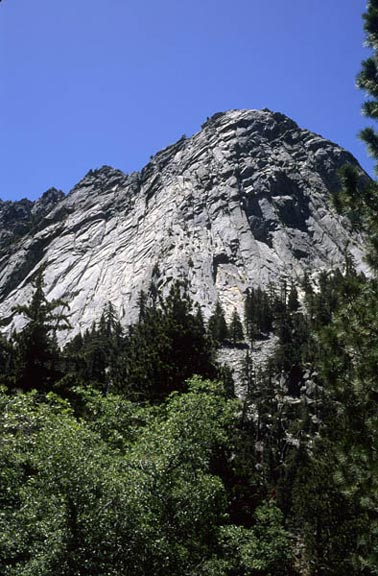 A low shot of Suicide Rock in the San Jacinto Mountains. This shot captures the striking height of the edifice as it towers of the lowland area.
