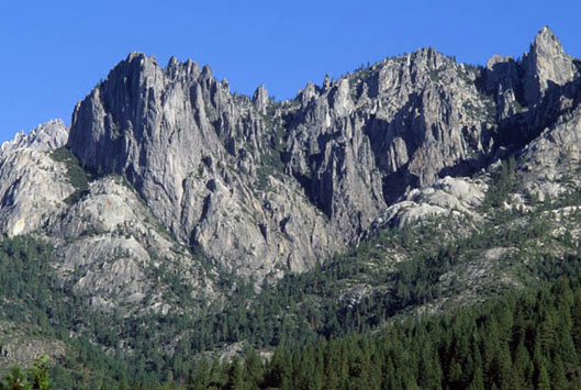 A ridge of the Castle Crags Wilderness juts up and along the mountain range.