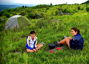 Kids camping in a meadow